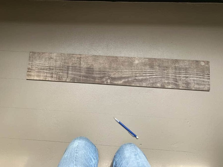 a piece of wood tile from Lowes Home and Improvment in Summerville, South Carolina