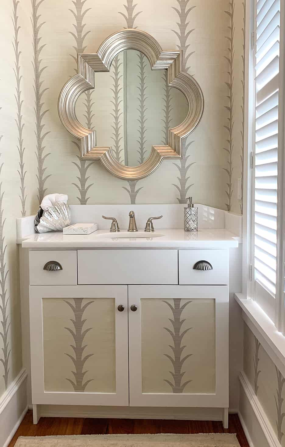 Palm Leaf Wall Finish in a bathroom with metallic linen glaze. Design also painted on vanity.