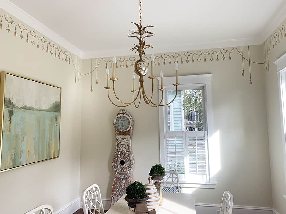 Gold Tassels and ornamental mural designs hand painted on dining room walls.